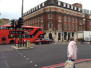A very Londonish bus.  By a very Londonish building near Euston Square.