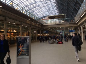 St. Pancras Station.  Trains to left, Fortnum & Mason down hall to right